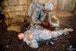 Combat Medic tends to Soldier Injured in combat trauma scenario