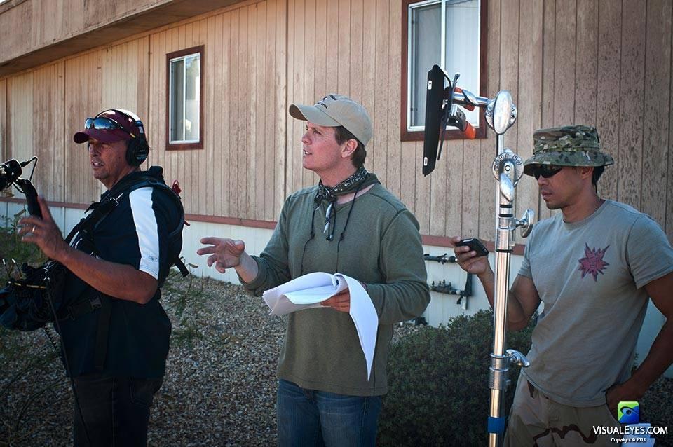 Dr. Gerard Gibbons Director VISUAL EYES Emotive Storytelling Team interviews Stryker Brigade Combat Team soldiers at Ft. Irwin.