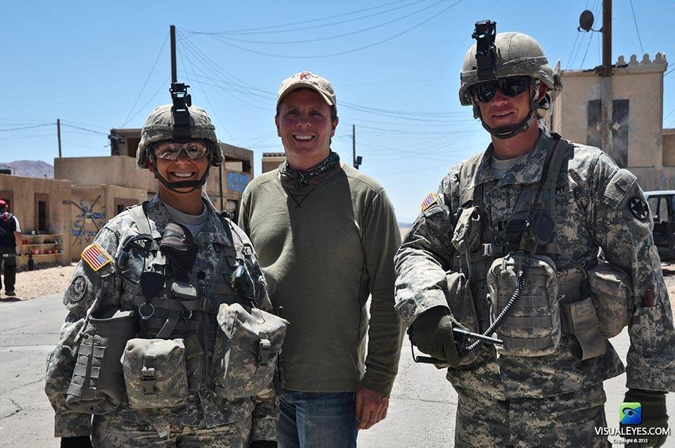 Dr. Gerard Gibbons Director VISUAL EYES Emotive Storytelling Team poses with officers with  the Stryker Brigade Combat Team